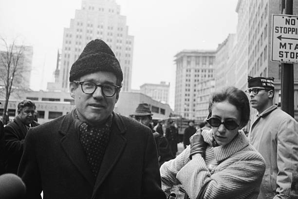 (Original Caption) Reverend William Sloane Coffin Jr., 43 the Chaplain at Yale University and his wife are seen here as he appeared at the U.S. District Court in Boston. Reverend Coffin, Dr. Spock and three other defendants pleaded innocent to charges of conspiring to aid young men in dodging the draft.