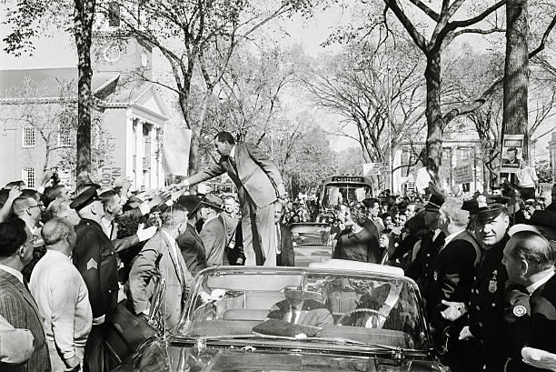 (Original Caption) 10/17/1960-New Haven, CT- Republican presidential candidate, Vice President Richard M. Nixon, greets an enthusiastic crowd from the top of a car. Nixon hit on the defense of the offshore Islands of Quemoy and Mahsu during his motor tour of Connecticut, pressing for a clearer statement of Senator Kennedy's views on this issue in his speech to the voters.